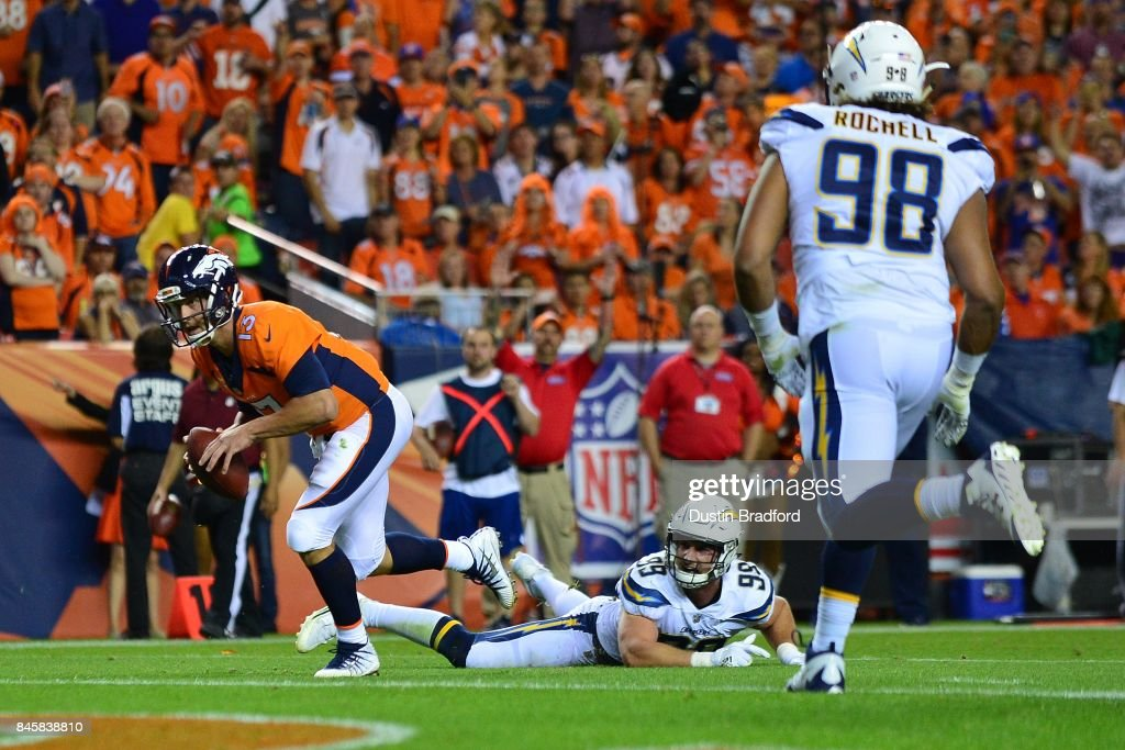Quarterback Trevor Siemian #13 of the Denver Broncos rushes for a touchdown in the second quarter at Sports Authority Field at Mile High on September 11, 2017 in Denver, Colorado.