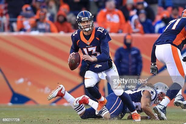 Quarterback Trevor Siemian of the Denver Broncos scrambles as he looks for a receiver downfield in the third quarter of a game against the New...