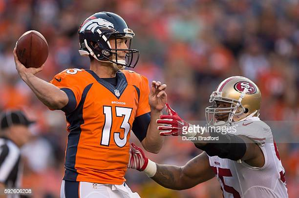 Quarterback Trevor Siemian of the Denver Broncos throws a first quarter pass under pressure by outside linebacker Ahmad Brooks of the San Francisco...