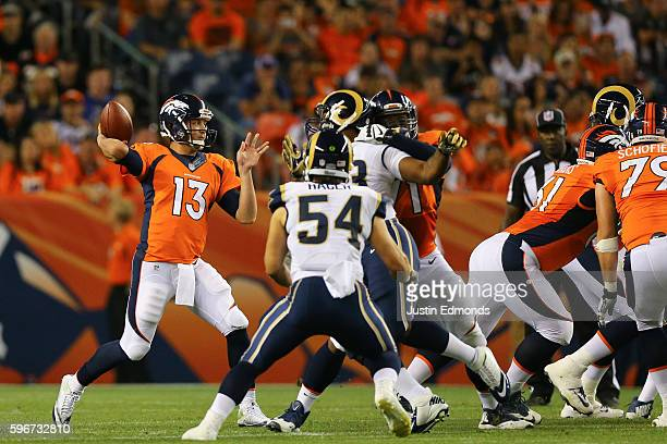Quarterback Trevor Siemian of the Denver Broncos throws a pass during the second quarter against the Los Angeles Rams at Sports Authority Field at...
