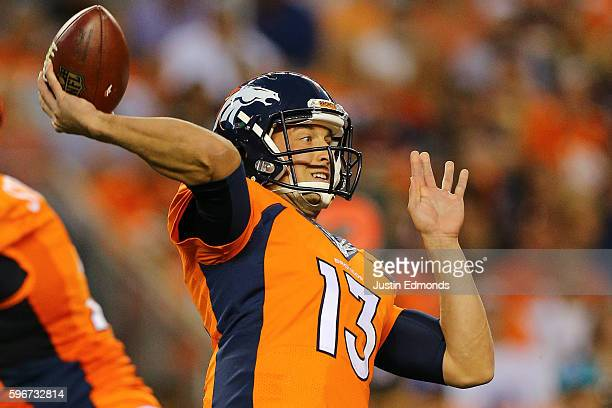 Quarterback Trevor Siemian of the Denver Broncos throws a pass during the first quarter against the Los Angeles Rams at Sports Authority Field at...