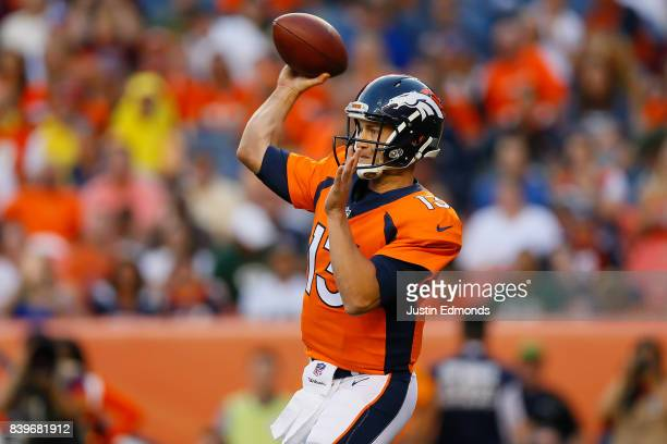 Quarterback Trevor Siemian of the Denver Broncos throws a pass in the first quarter during a Preseason game against the Green Bay Packers at Sports...