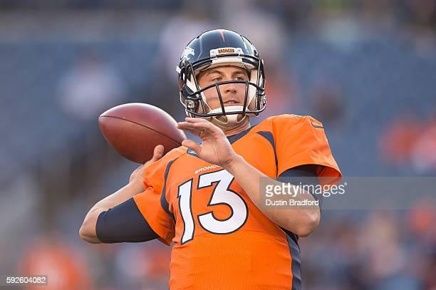 Quarterback Trevor Siemian of the Denver Broncos throws as he warms up before a preseason NFL game at Sports Authority Field at Mile High on August...