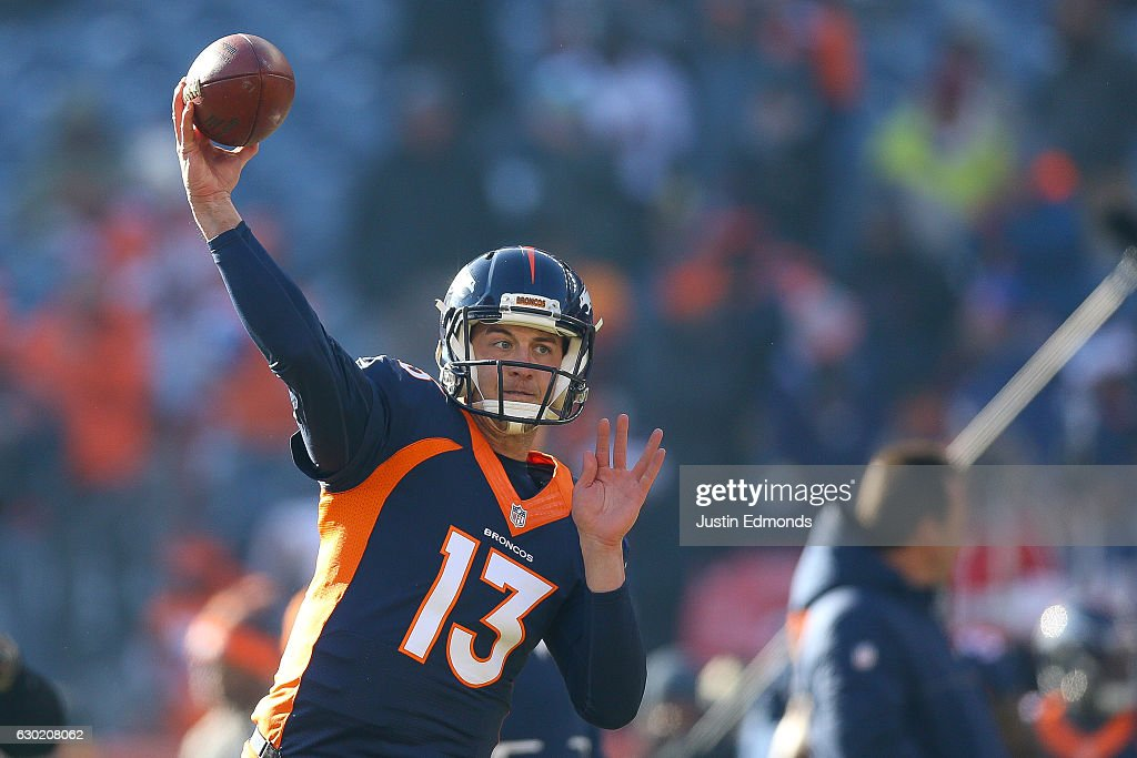 Quarterback Trevor Siemian #13 of the Denver Broncos throws as he warms up before a game against the New England Patriots at Sports Authority Field at Mile High on December 18, 2016 in Denver, Colorado.