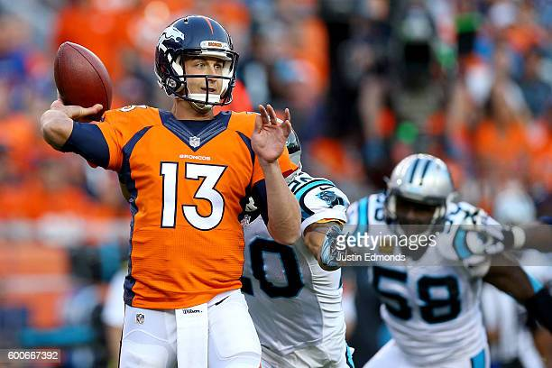 Quarterback Trevor Siemian of the Denver Broncos throws the ball in the first quarter as outside linebacker Thomas Davis of the Carolina Panthers...