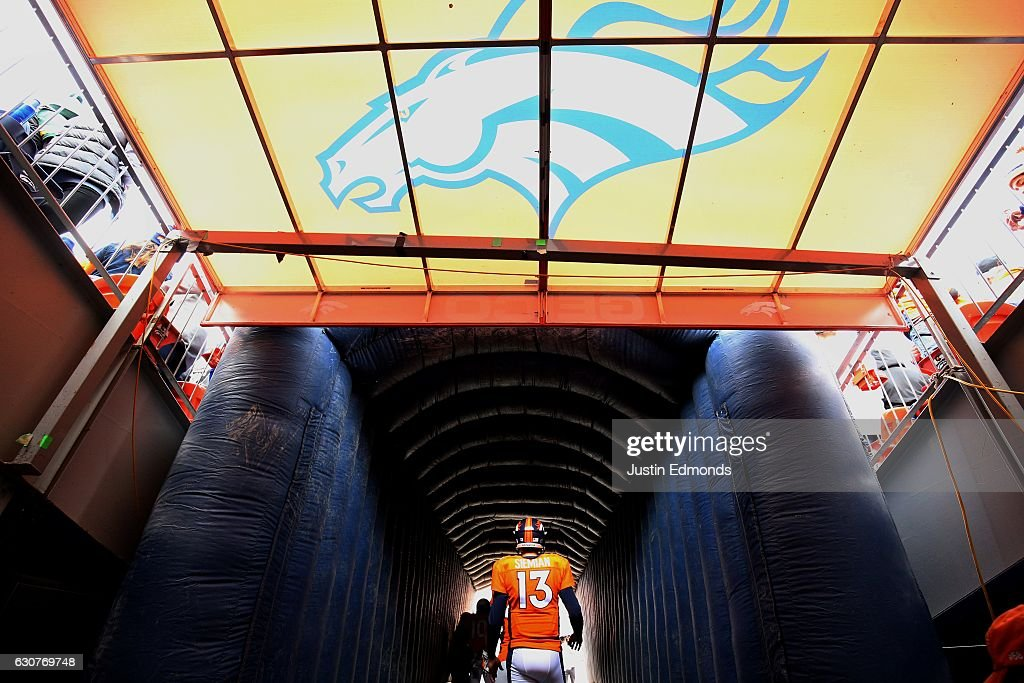 Quarterback Trevor Siemian #13 of the Denver Broncos waits to take the field before the game against the Oakland Raiders at Sports Authority Field at Mile High on January 1, 2017 in Denver, Colorado.