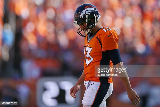 Quarterback Trevor Siemian of the Denver Broncos walks off the field at Sports Authority Field at Mile High on September 18 2016 in Denver Colorado
