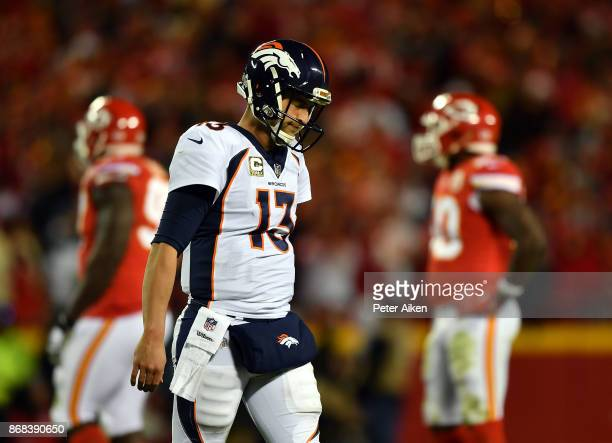 Quarterback Trevor Siemian of the Denver Broncos walks off the field after throwing an interception during the game against the Kansas City Chiefs at...