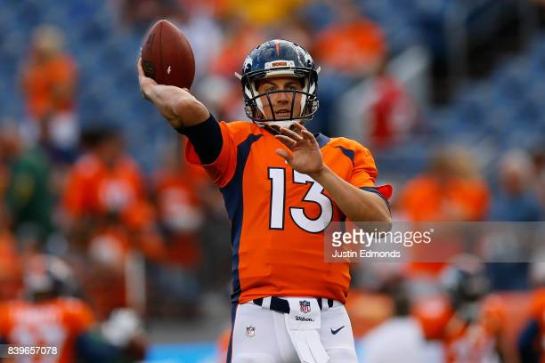 Quarterback Trevor Siemian of the Denver Broncos warms up before a Preseason game against the Green Bay Packers at Sports Authority Field at Mile...