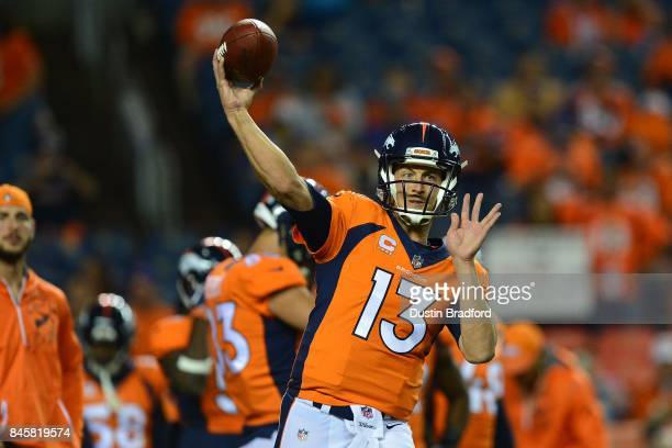 Quarterback Trevor Siemian of the Denver Broncos warms up before the game against the Los Angeles Chargers at Sports Authority Field at Mile High on...