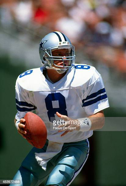 Quarterback Troy Aikam of the Dallas Cowboys drops back to pass during an NFL football game circa 1989 Aikman played for the Cowboys from 198900
