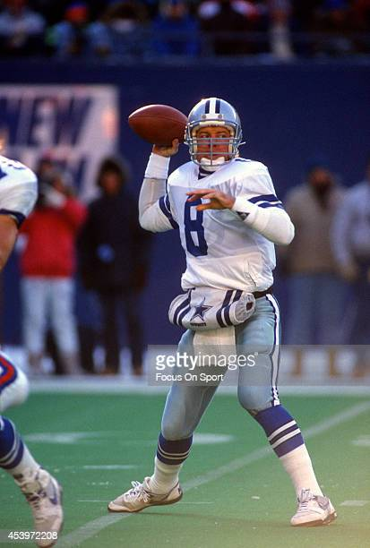 Quarterback Troy Aikam of the Dallas Cowboys drops back to pass against the New York Giants during an NFL football game December 16 1989 at Giants...