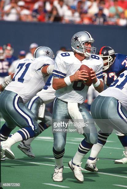 Quarterback Troy Aikam of the Dallas Cowboys drops back to pass against the New York Giants during an NFL football game September 13 1992 at Giants...