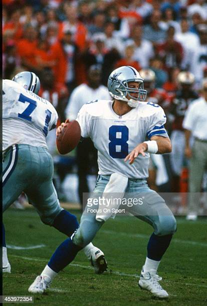 Quarterback Troy Aikam of the Dallas Cowboys drops back to pass against the San Francisco 49ers during an NFL football game November 10 1996 at...