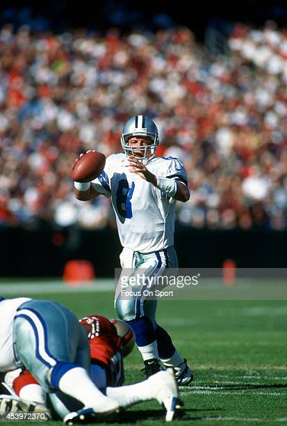 Quarterback Troy Aikam of the Dallas Cowboys drops back to pass against the San Francisco 49ers during an NFL football game November 2 1997 at...