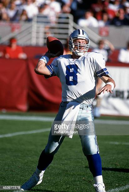 Quarterback Troy Aikam of the Dallas Cowboys drops back to pass against the Arizona Cardinals during an NFL football game December 8 1996 at Sun...