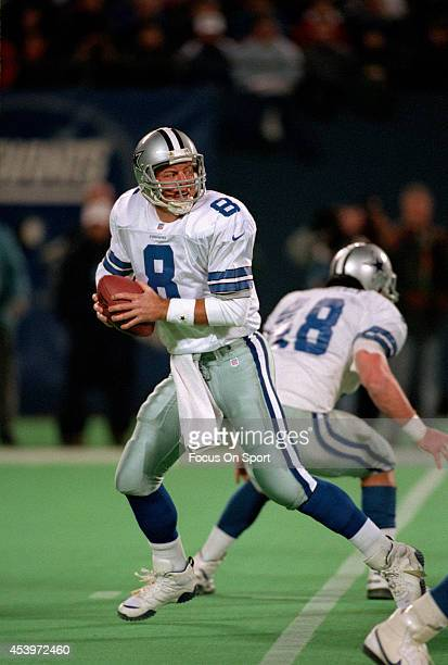 Quarterback Troy Aikam of the Dallas Cowboys drops back to pass against the New York Giants during an NFL football game November 24 1996 at Giants...