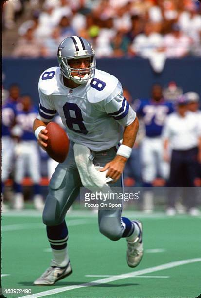 Quarterback Troy Aikam of the Dallas Cowboys rolls out to pass against the New York Giants during an NFL football game September 13 1992 at Giants...