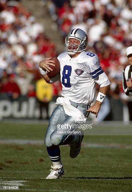 Quarterback Troy Aikam of the Dallas Cowboys runs with the ball during circa 1995 NFL football game Aikman played for the Cowboys from 198900