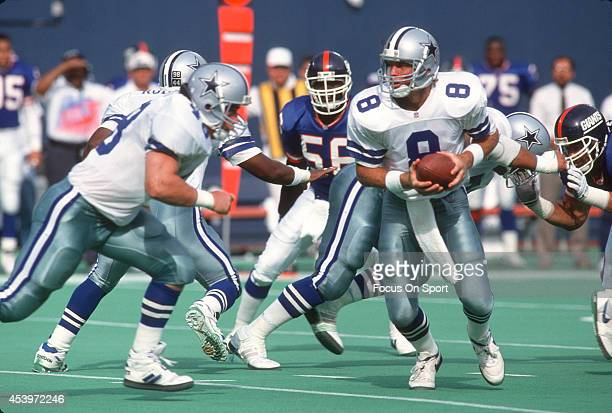 Quarterback Troy Aikam of the Dallas Cowboys turns to hand the ball off against the New York Giants during an NFL football game September 13 1992 at...