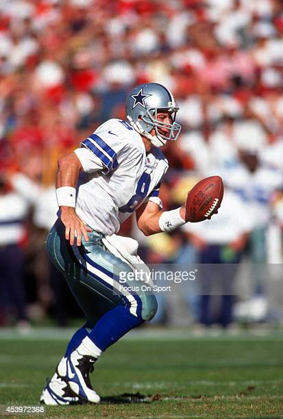Quarterback Troy Aikam of the Dallas Cowboys turns to hand the ball off to a running back against the San Francisco 49ers during an NFL football game...