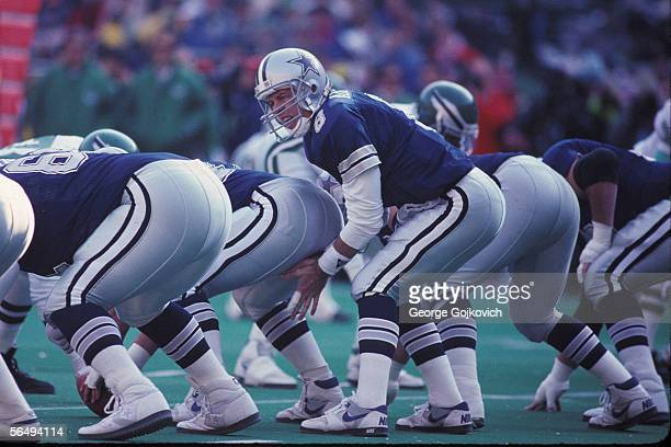 Quarterback Troy Aikman of the Dallas Cowboys prepares to take the ball from the center at the line of scrimmage during a game against the...
