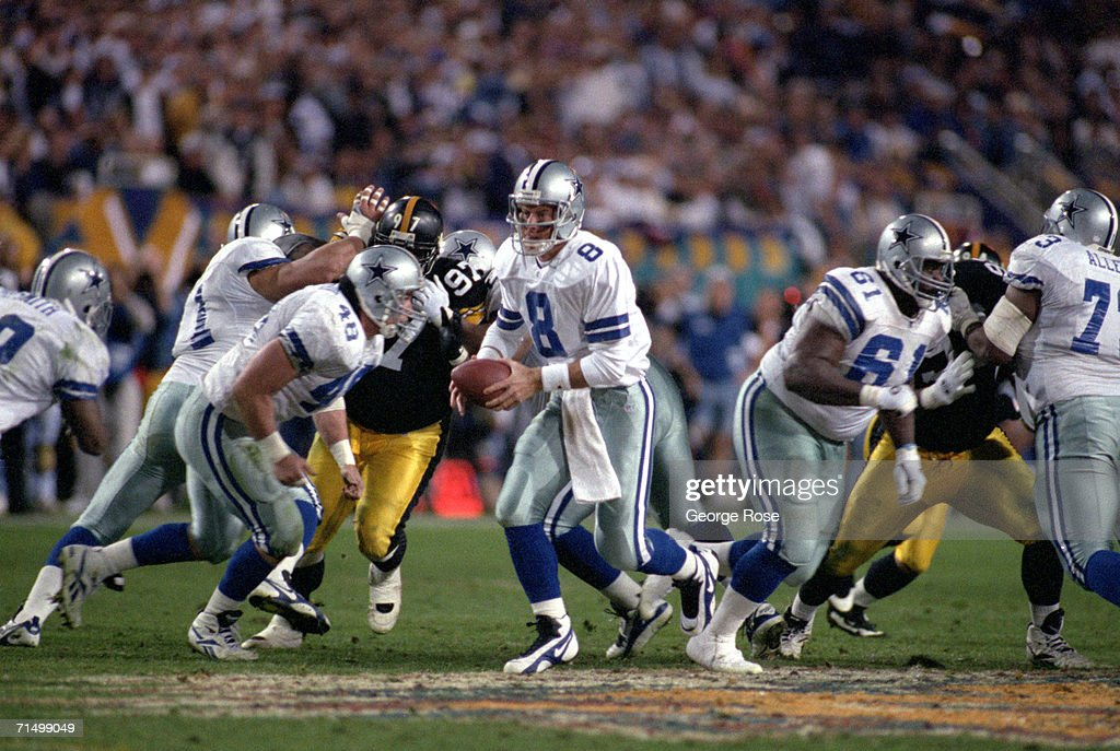Quarterback Troy Aikman #8 of the Dallas Cowboys runs a play during Super Bowl XXX against the Pittsburgh Steelers at Sun Devil Stadium on January 28, 1996 in Tempe, Arizona. The Cowboys won 27-17.