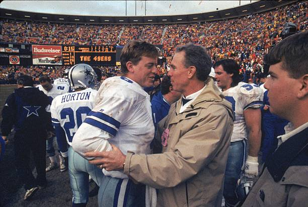Quarterback Troy Aikman of the Dallas Cowboys talks to Roger Staubach after winning against the San Francisco 49ers in the 1992 NFC Championship Game...