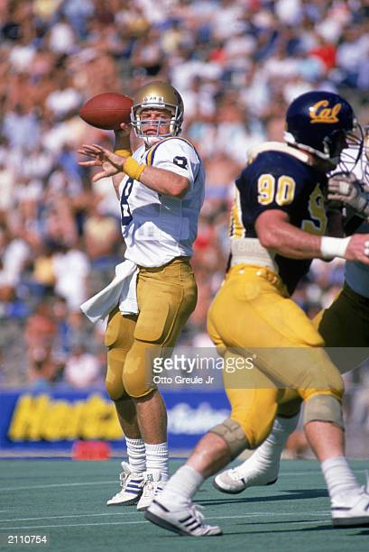 Quarterback Troy Aikman of the University of California at Los Angeles Bruins passes during a game against the California Golden Bears on October 15...