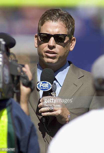 HOF quarterback Troy Aikman who played for the Dallas Cowboys announcing for Fox Sports from the sidelines prior to the game between the New York...
