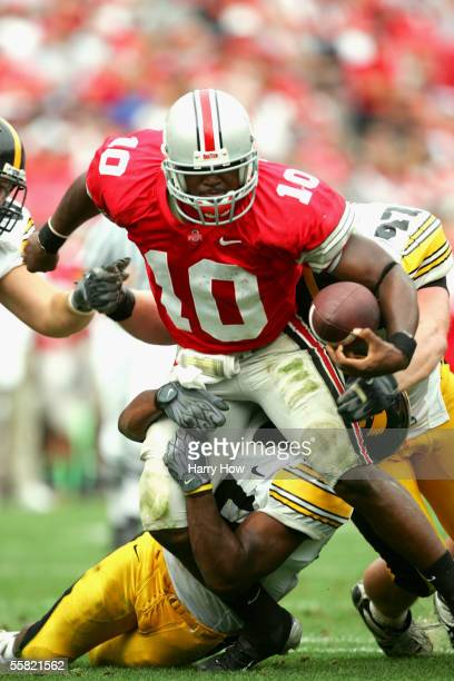 Quarterback Troy Smith of Ohio State University Buckeyes scrambles with the ball against the University of Iowa Hawkeyes at Ohio Stadium on September...