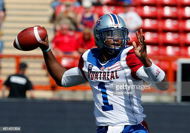 Quarterback Troy Smith of the Montreal Alouettes throws the ball in the second half of their CFL football game against the Calgary Stampeders at...