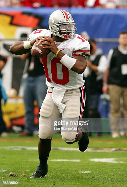 Quarterback Troy Smith of the Ohio State Buckeyes looks to pass against the Notre Dame Fighting Irish in the Tostito's Fiesta Bowl at Sun Devil...