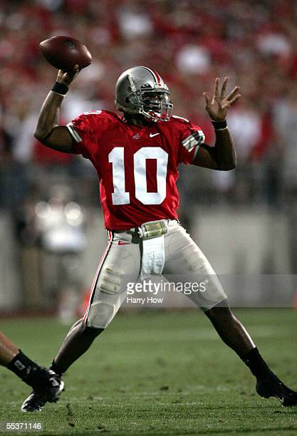Quarterback Troy Smith of the Ohio State Buckeyes sets to pass in the pocket against the Texas Longhorns during the second quarter at Ohio Stadium on...