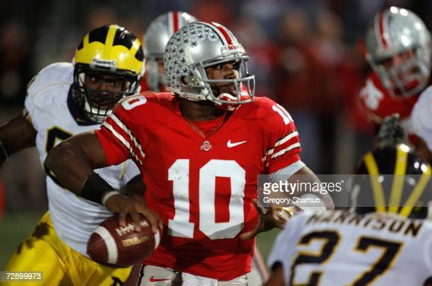 Quarterback Troy Smith of the Ohio State Buckeyes throws a 3 quarter interception under pressure from the Michigan Wolverines defense November 18,...