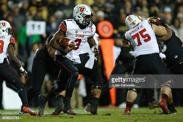 Quarterback Troy Williams of the Utah Utes runs with the football during the second quarter against the Colorado Buffaloes at Folsom Field on...