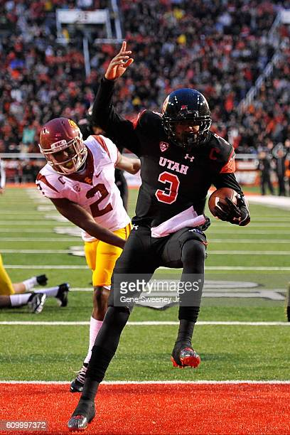 Quarterback Troy Williams of the Utah Utes scores a first quarter touchdown against the USC Trojans at Rice-Eccles Stadium on September 23, 2016 in...
