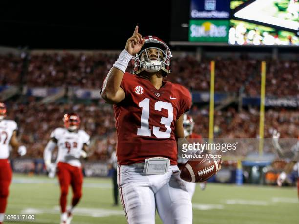 Quarterback Tua Tagovailoa of the Alabama Crimson Tide points to the sky while celebrates after a score during the game against the Louisville...