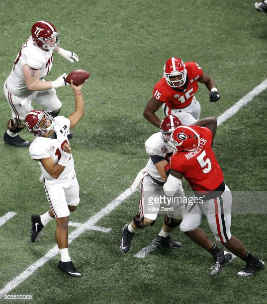 Quarterback Tua Tagovailoa of the Alabama Crimson Tide throws a pass during the College Football Playoff National Championship game against the...