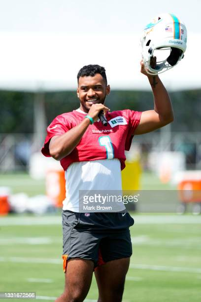 Quarterback Tua Tagovailoa of the Miami Dolphins greets the fans before the start Training Camp at Baptist Health Training Complex on July 31, 2021...