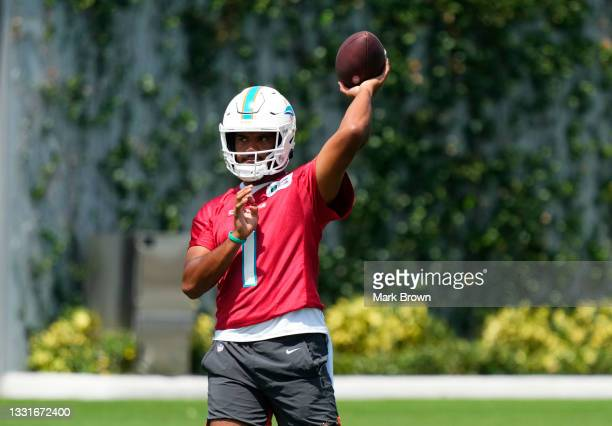 Quarterback Tua Tagovailoa of the Miami Dolphins throws a pass during Training Camp at Baptist Health Training Complex on July 31, 2021 in Miami...