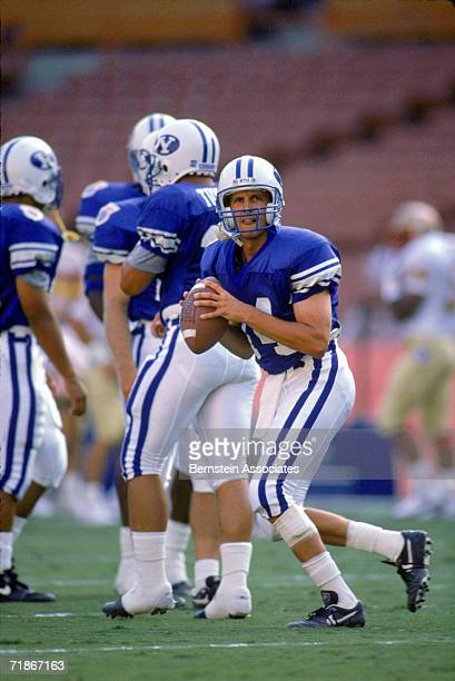 Quarterback Ty Detmer Quaterback Ty Detmer of the Brigham Young University Courgars practices for the Pigskin Classic against the Florida State...