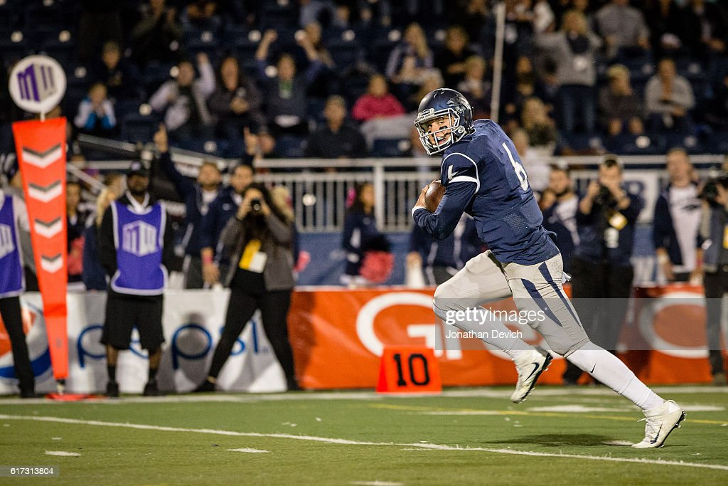 Quarterback Ty Gangi #6 of Nevada runs for a touchdown against Wyoming at Mackay Stadium on October 22, 2016 in Reno, Nevada.