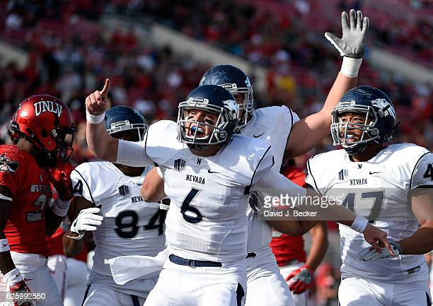 Quarterback Ty Gangi of the Nevada Wolf Pack celebrates his first half touchdown against the UNLV Rebels at Sam Boyd Stadium on November 26 2016 in...