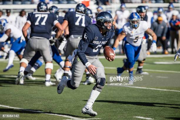 Quarterback Ty Gangi of the Nevada Wolf Pack gets past the San Jose State Spartans defense at Mackay Stadium on November 11 2017 in Reno Nevada