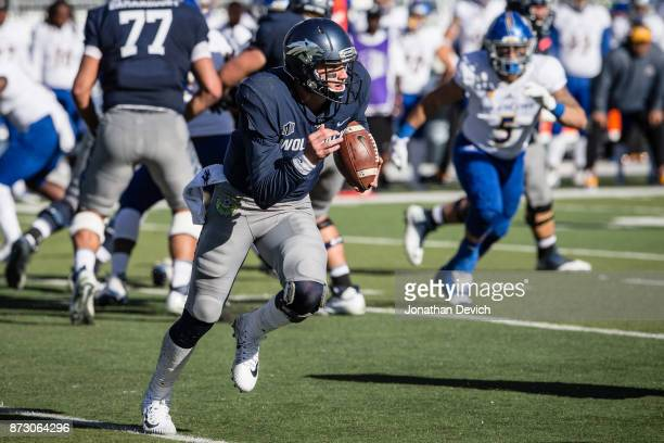 Quarterback Ty Gangi of the Nevada Wolf Pack runs the ball against the San Jose State Spartans at Mackay Stadium on November 11 2017 in Reno Nevada