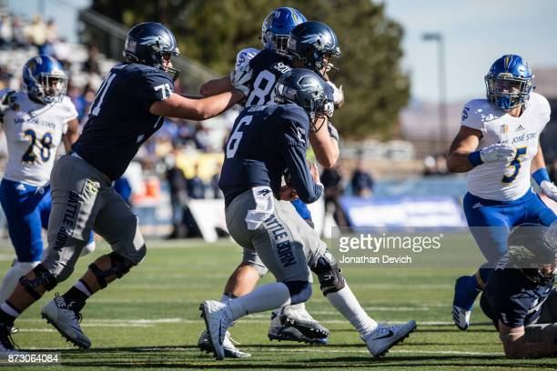 Quarterback Ty Gangi of the Nevada Wolf Pack runs with the ball against the San Jose State Spartans at Mackay Stadium on November 11 2017 in Reno...