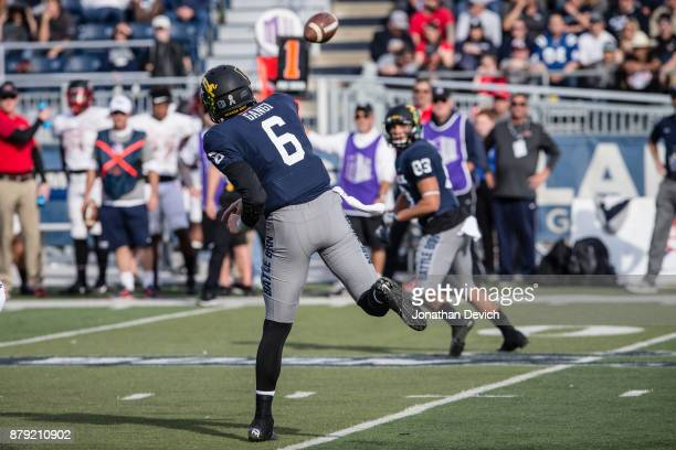 Quarterback Ty Gangi of the Nevada Wolf Pack throws the ball to wide receiver Andrew Celis of the Nevada Wolf Pack during a play against the UNLV...