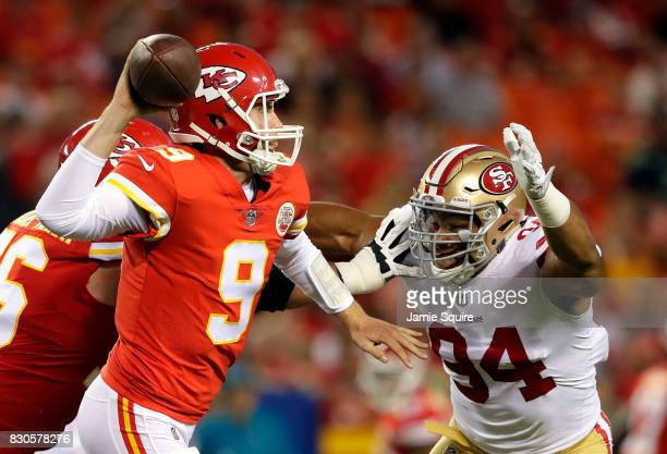 Quarterback Tyler Bray of the Kansas City Chiefs passes as defensive end Solomon Thomas of the San Francisco 49ers defends during the preseason game...