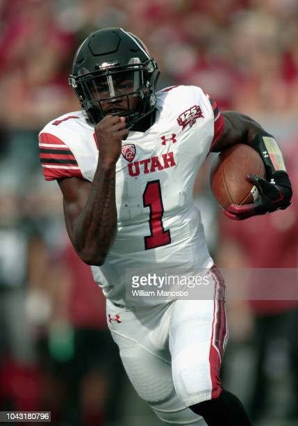 Quarterback Tyler Huntley of the Utah Utes carries the ball against the Washington State Cougars in the first half at Martin Stadium on September 29...